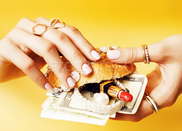 woman hands holding hamburger with money, jewelry, cosmetic, social issue wealth concept  Stock photo © iordani
