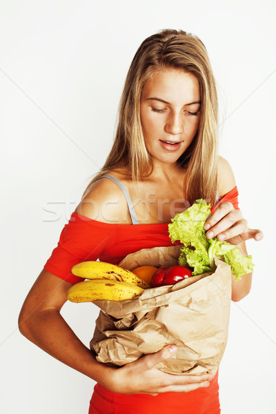 young pretty blond woman at shopping with food in paper bag isol Stock photo © iordani