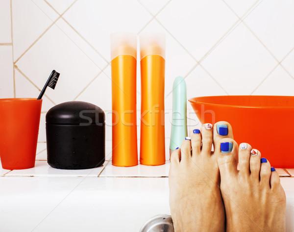 woman legs in bathroom with lot of stylish stuff for care, pedic Stock photo © iordani