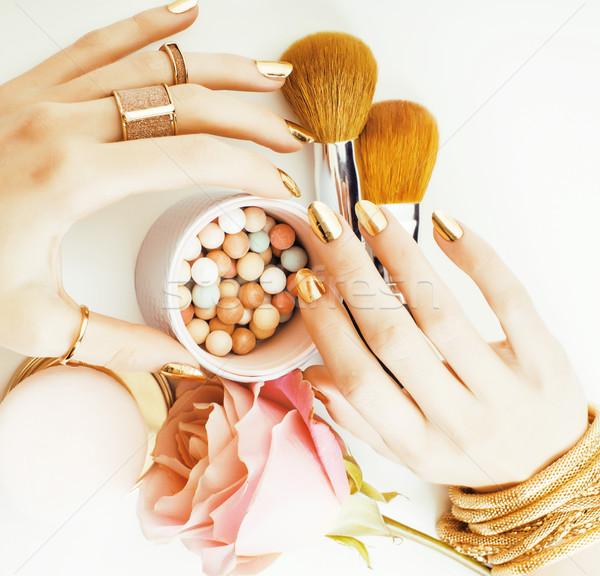 Frau Hände golden Maniküre viele Ringe Stock foto © iordani