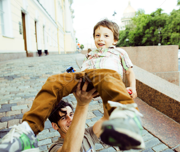 little son with father in city hagging and smiling Stock photo © iordani