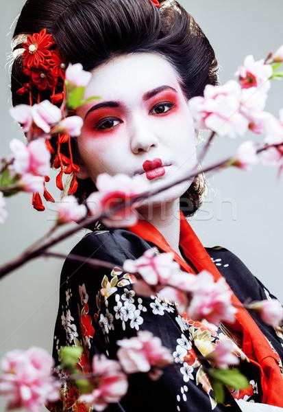 Genç güzel geyşa kimono sakura kırmızı Stok fotoğraf © iordani