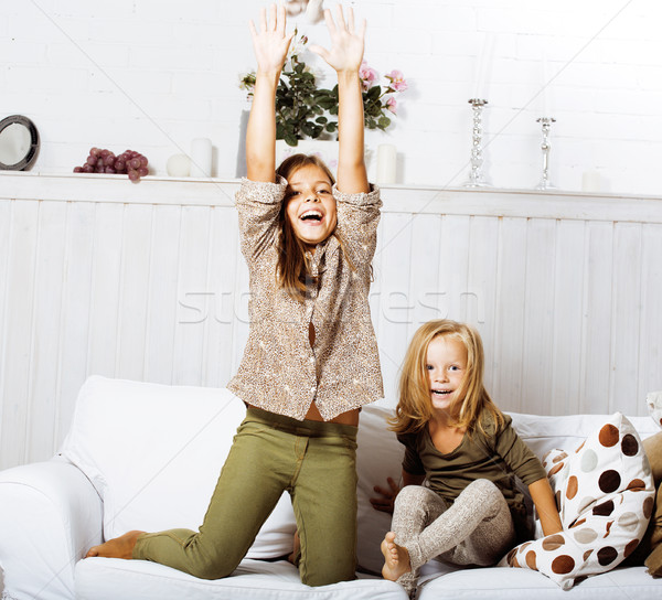 two cute sisters at home playing, little girl in house interior Stock photo © iordani