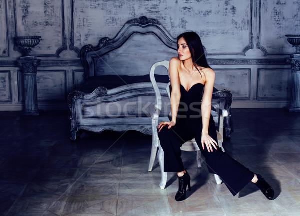 beauty young brunette woman in luxury home interior, fairy bedroom grey stylish Stock photo © iordani