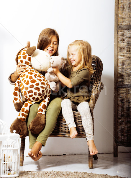 Kettő aranyos nővérek otthon játszik kislány Stock fotó © iordani