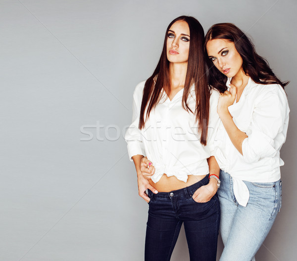 two sisters twins posing, making photo selfie, dressed same whit Stock photo © iordani