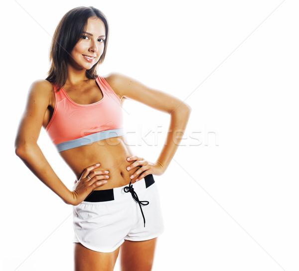 Fiatal csinos nő sportok visel izolált fehér Stock fotó © iordani