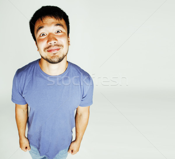 young cute asian man on white background gesturing emotional, po Stock photo © iordani