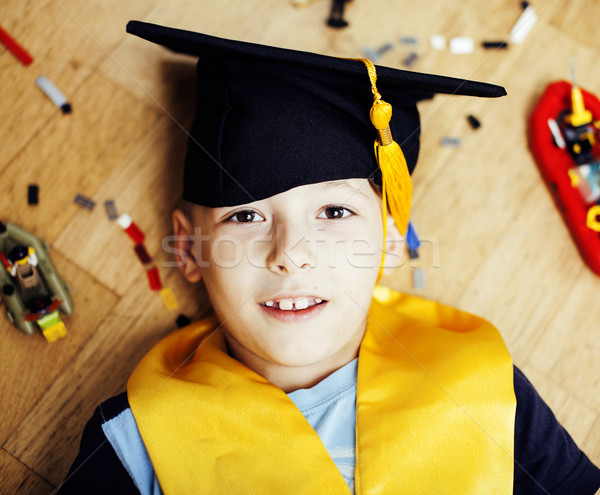little cute preschooler boy among toys lego at home education in graduate hat smiling posing emotion Stock photo © iordani