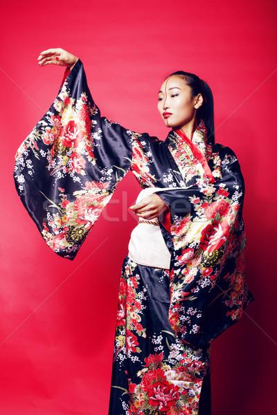 Fiatal csinos gésa piros pózol kimonó Stock fotó © iordani