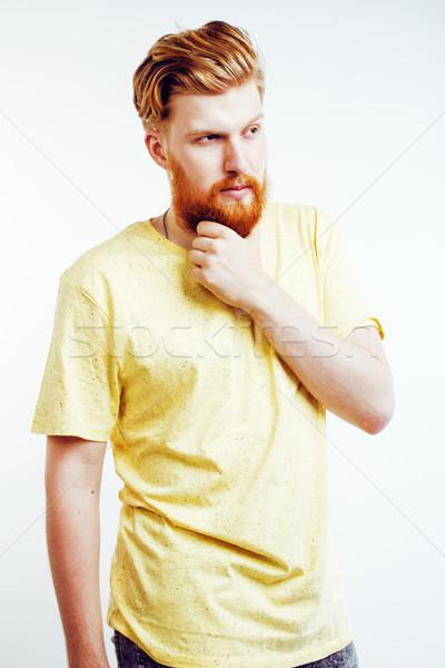 Fiatal jóképű hipszter szakállas fickó néz Stock fotó © iordani