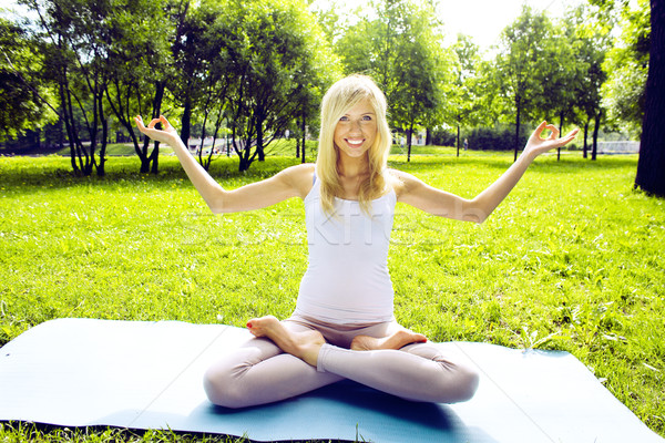 blonde happy smiling girl doing yoga in park, lifestyle sport people concept Stock photo © iordani