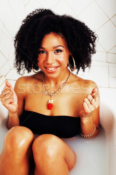 Fiatal tinilány fektet fürdőkád hab visel Stock fotó © iordani