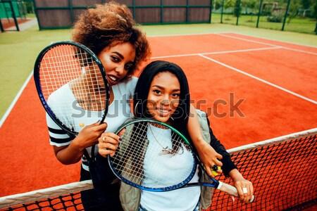 young pretty girlfriends hanging on tennis court, fashion stylis Stock photo © iordani