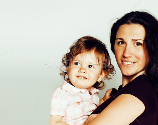 young pretty stylish mother with little cute blond daughter hugging, happy smiling real family, life Stock photo © iordani