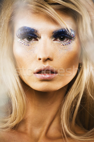 beauty young snow queen lady in fairy flashes with hair crown on her head close up in cold blue ligh Stock photo © iordani