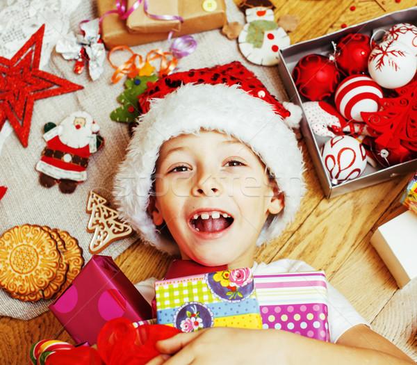 Kicsi aranyos gyerek piros kalap kézzel készített Stock fotó © iordani