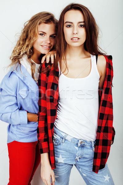 two best friends teenage girls together having fun, posing emotional on white background, besties ha Stock photo © iordani