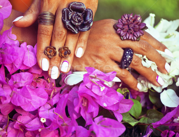 bright colorfull shot of african tanned hands with manicure amon Stock photo © iordani