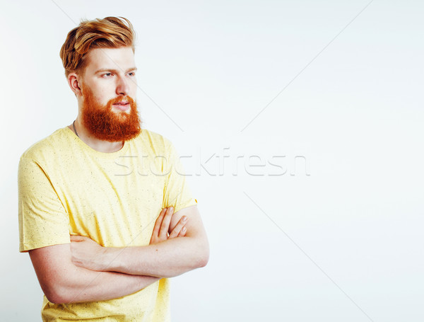 Stock photo: young handsome hipster ginger bearded guy looking brutal isolated on white background, lifestyle peo