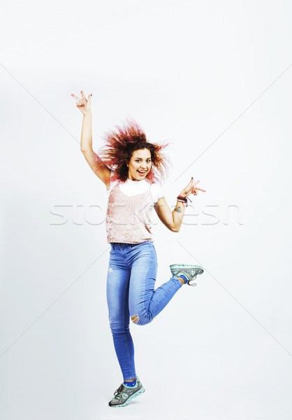 young pretty jumping mulatto woman posing cheerful emotional isolated on white background, lifestyle Stock photo © iordani
