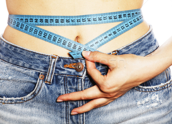 girls stomach measuring with tape twice isolated close up Stock photo © iordani