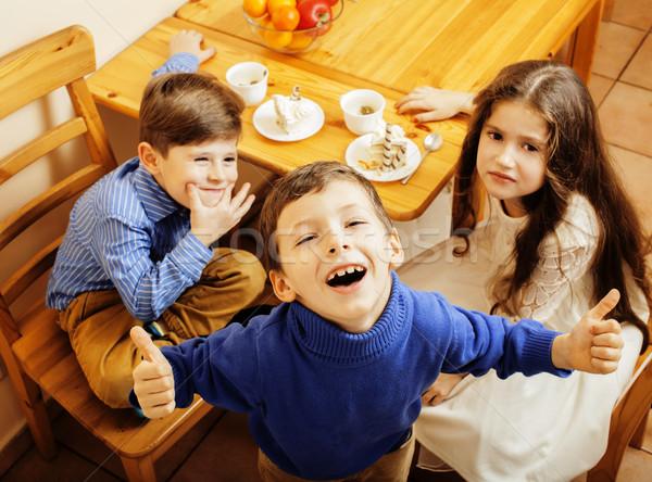 Küçük sevimli erkek yeme tatlı ahşap Stok fotoğraf © iordani
