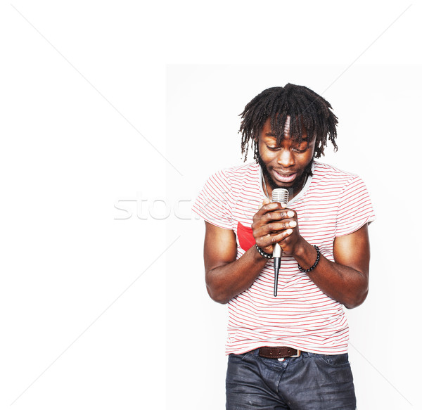 young handsome african american boy singing emotional with micro Stock photo © iordani