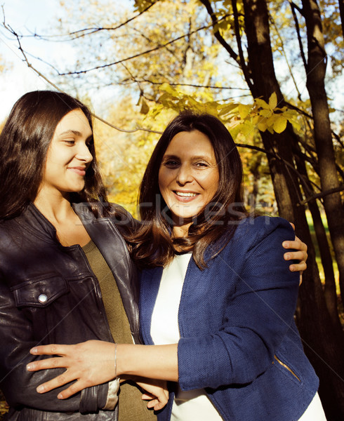 mature real mother with daughter outside autumn fall in park Stock photo © iordani