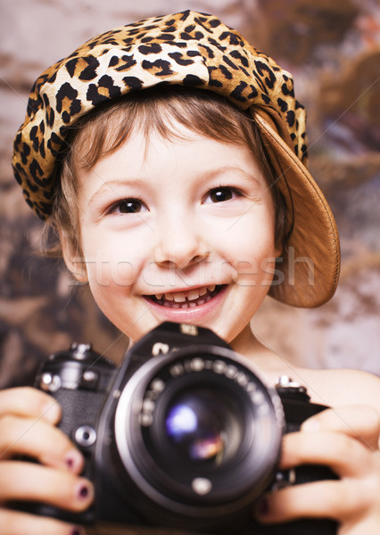 little cute boy in leopard cap and camera, young fashion photographer Stock photo © iordani