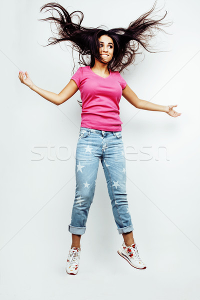 young happy smiling latin american teenage girl emotional posing on white background, jumping flying Stock photo © iordani