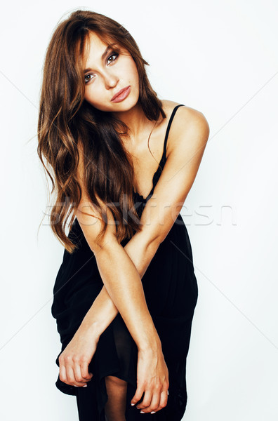 young brunette pretty woman in black dress posing on white background, lifestyle people concept  Stock photo © iordani