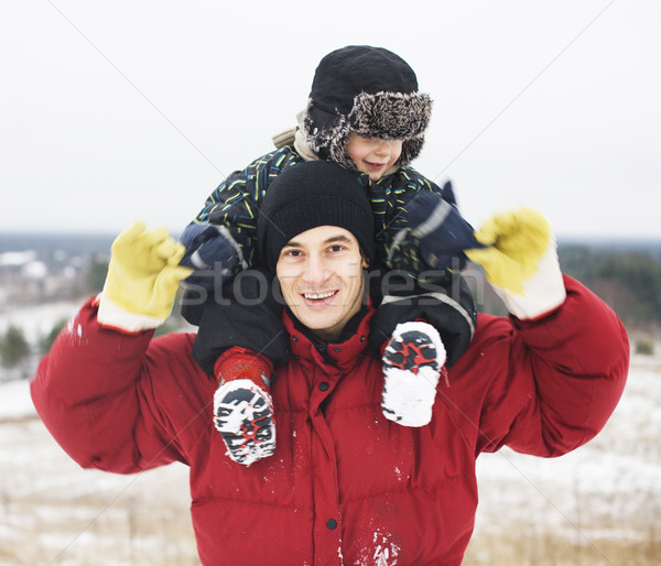portrait of happy father with his son outside in winter landscape, lifestyle people concept, real fa Stock photo © iordani