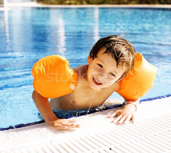 little cute boy in swimming pool wearing handcarves Stock photo © iordani