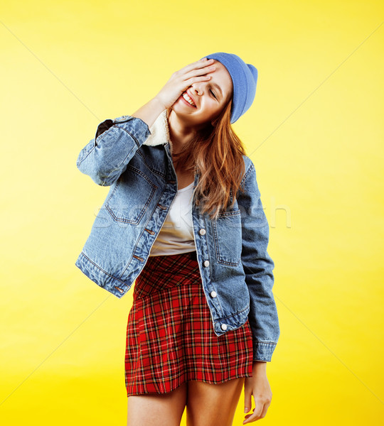young pretty red hair teenage hipster girl posing in glasses emotional happy smiling on yellow backg Stock photo © iordani