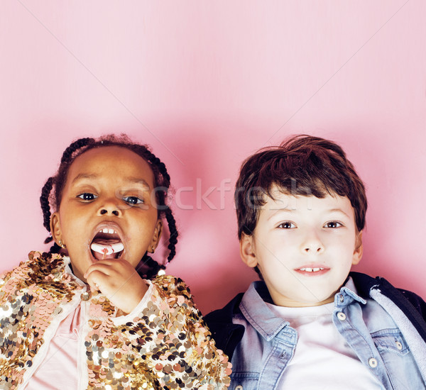 lifestyle people concept: diverse nation children playing together, caucasian boy with african littl Stock photo © iordani