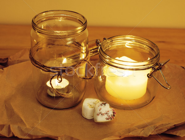 candles in glass burning romantic celebration concept wooden kitchen close up Stock photo © iordani