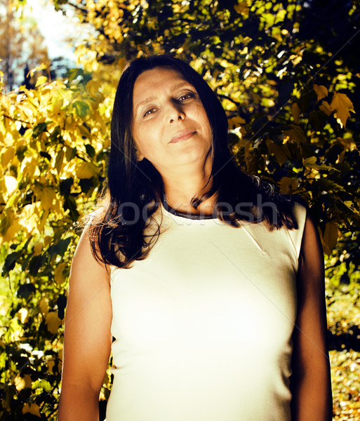 mature real brunette woman in green spring park, lifestyle conce Stock photo © iordani