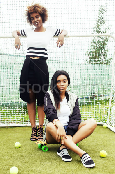 young pretty multi ethnicity afro-american girls having fun on f Stock photo © iordani