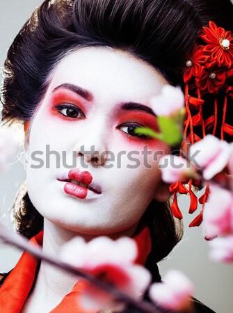 Mooie brunette vrouw steeg sieraden zwarte Stockfoto © iordani