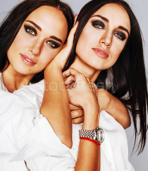 two sisters twins posing, making photo selfie, dressed same whit Stock photo © iordani