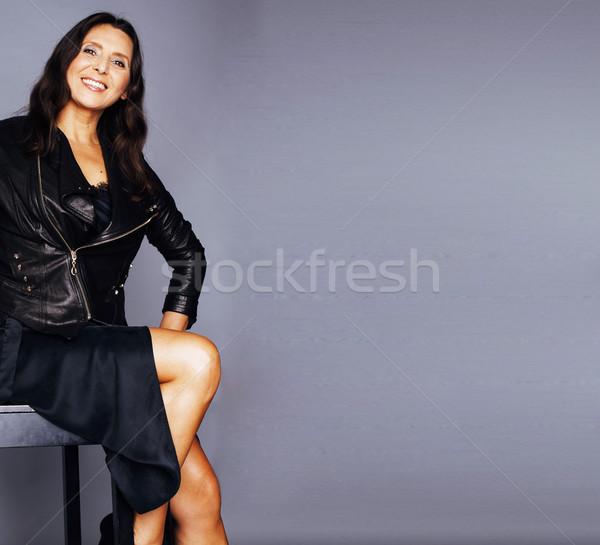 Güzel esmer olgun kadın oturma sandalye stüdyo Stok fotoğraf © iordani
