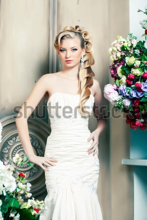 Stock photo: beauty young blond woman bride alone in luxury vintage interior with a lot of flowers