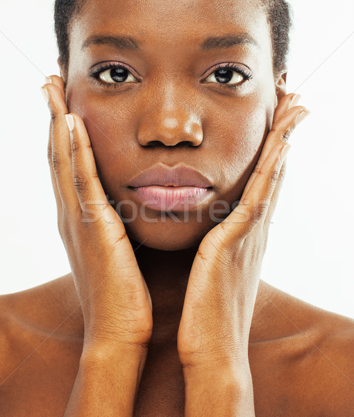 young pretty african american woman naked taking care of her skin isolated on white background, heal Stock photo © iordani