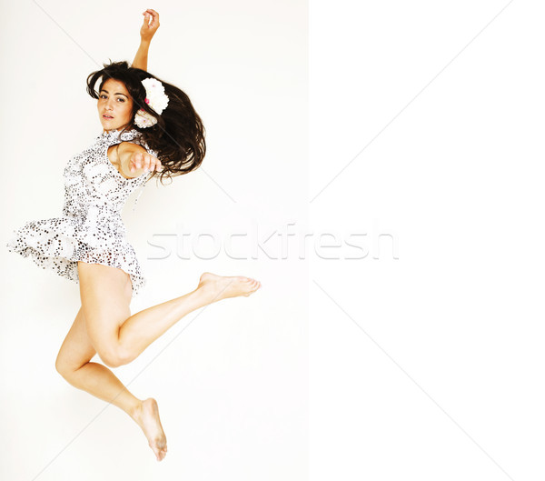 young pretty teenage girl jumping cheerful isolated on white bac Stock photo © iordani