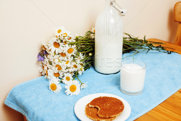Simply stylish wooden kitchen with bottle of milk and glass on t Stock photo © iordani