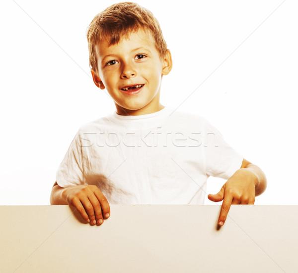 little cute boy holding empty shit to copyspace isolated close u Stock photo © iordani