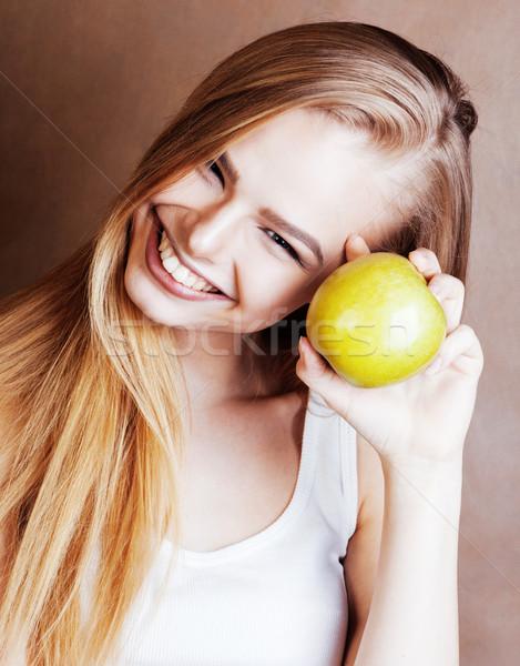 Genç güzel sarışın kadın yeşil elma Stok fotoğraf © iordani