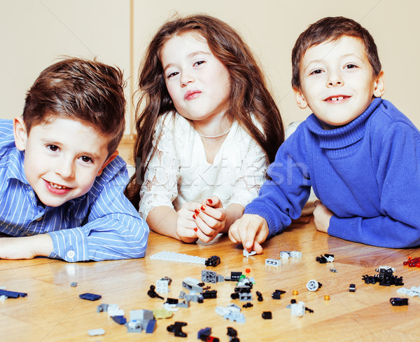 funny cute children playing toys at home, boys and girl smiling, first education role lifestyle  Stock photo © iordani