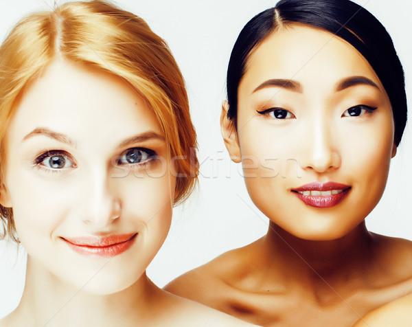 Diferente mulher asiático caucasiano juntos isolado Foto stock © iordani